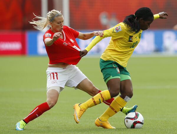 Lara Dickenmann #11 of Switzerland and Claudine Meffometou Tcheno #12 of Cameroon battle for the ball during the FIFA Women's World Cup Canada Group C match between Switzerland and Cameroon at Commonwealth Stadium on June 16, 2015 in Edmonton, Alberta, Canada.  (June 15, 2015 - Source: Todd Korol/Getty Images North America)
