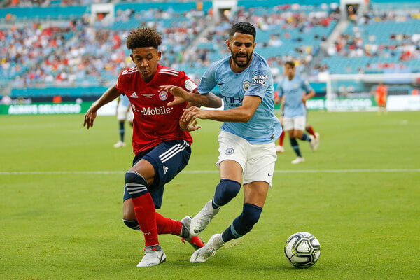 Chris Richards #34 of Bayern Munich defends Riyad Mahrez #26 of Manchester City during the first half of the International Champions Cup at Hard Rock Stadium on July 28, 2018 in Miami, Florida.  (July 27, 2018 - Source: Michael Reaves/Getty Images North America)