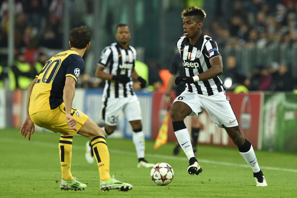 Paul Pogba (R) of Juventus in action against Juanfran of Club Atletico de Madrid during the UEFA Champions League group A match between Juventus and Club Atletico de Madrid at Juventus Arena on December 9, 2014 in Turin, Italy.  (Dec. 8, 2014 - Source: Valerio Pennicino/Getty Images Europe)