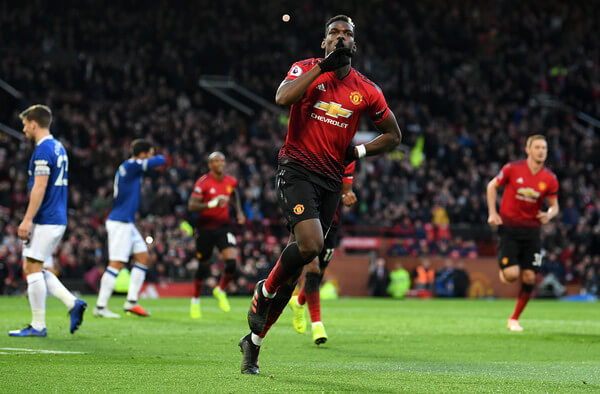 Paul Pogba of Manchester United celebrates after scoring his team's first goal during the Premier League match between Manchester United and Everton FC at Old Trafford on October 28, 2018 in Manchester, United Kingdom.  (Oct. 27, 2018 - Source: Michael Regan/Getty Images Europe)