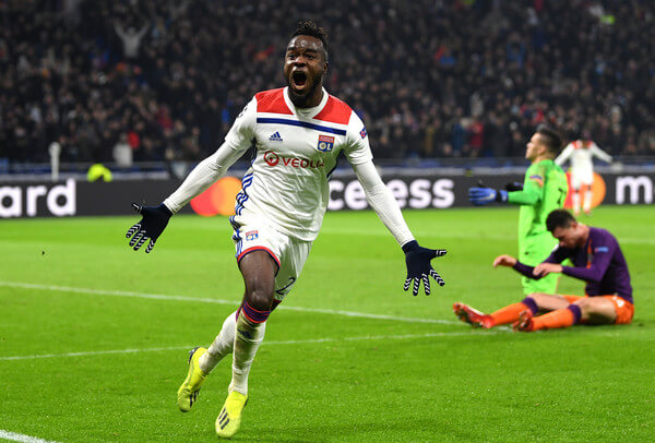 Maxwel Cornet of Olympique Lyonnais celebrates as he scores his team's second goal during the UEFA Champions League Group F match between Olympique Lyonnais and Manchester City at Groupama Stadium on November 27, 2018 in Lyon, France.  (Nov. 26, 2018 - Source: Shaun Botterill/Getty Images Europe)