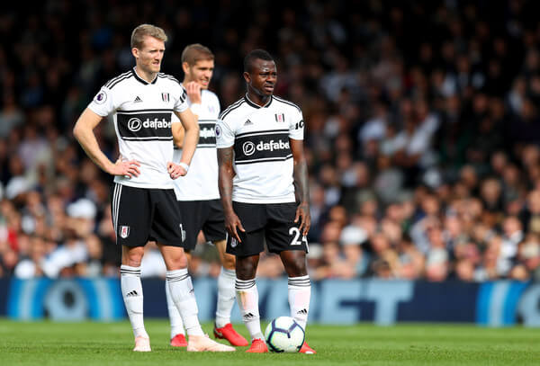 Andre Schurrle and Jean Michael Seri of Fulham during the Premier League match between Fulham FC and Arsenal FC at Craven Cottage on October 7, 2018 in London, United Kingdom.  (Oct. 6, 2018 - Source: Catherine Ivill/Getty Images Europe)