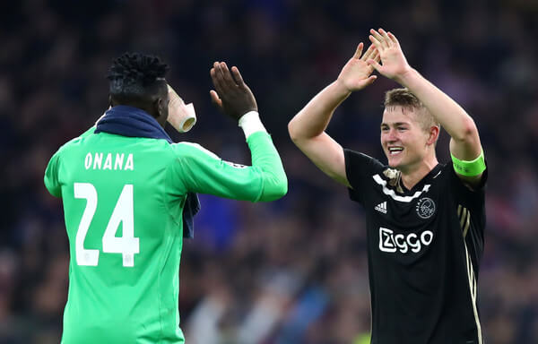 Andre Onana of Ajax and Matthijs de Ligt of Ajax celebrate following their sides victory in the Group E match of the UEFA Champions League between Ajax and SL Benfica at Johan Cruyff Arena on October 23, 2018 in Amsterdam, Netherlands.  (Oct. 22, 2018 - Source: Dean Mouhtaropoulos/Getty Images Europe)
