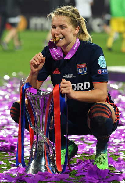 Ada Hegerberg of Lyon celebrates with the trophy during the UEFA Womens Champions League Final between VfL Wolfsburg and Olympique Lyonnais on May 24, 2018 in Kiev, Ukraine.  (May 23, 2018 - Source: David Ramos/Getty Images Europe)