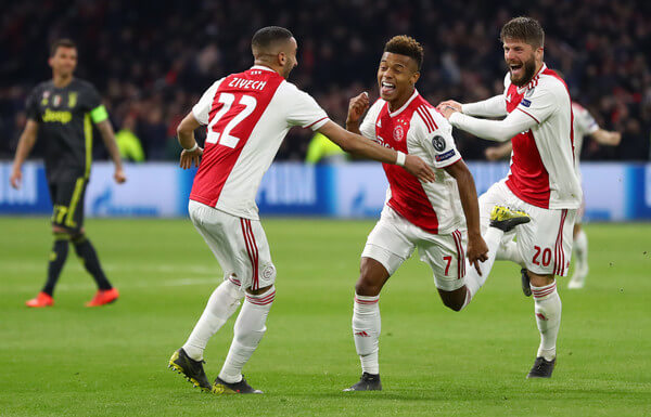 David Neres of Ajax celebrates with teammates after scoring his team's first goal during the UEFA Champions League Quarter Final first leg match between Ajax and Juventus at Johan Cruyff Arena on April 10, 2019 in Amsterdam, Netherlands.  (April 9, 2019 - Source: Getty Images Europe)