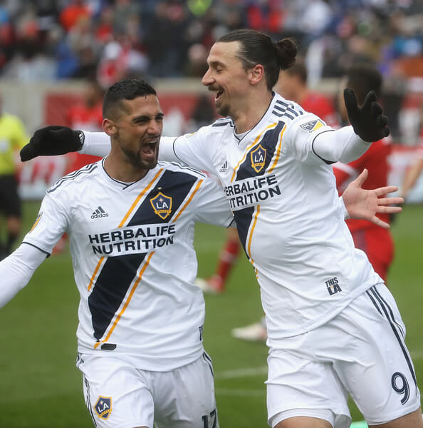 Zlatan Ibrahimovic #9 and Sebastian Lletget #17 of the Los Angeles Galaxy celebrate Ibrahimovics' first half goal against the Chicago Fire at Toyota Park on April 14, 2018 in Bridgeview, Illinois. The Galaxy defeated the Fire 1-0.  (April 13, 2018 - Source: Jonathan Daniel/Getty Images North America)
