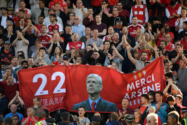 Fans hold up signs celebrating Arsene Wenger after the Premier League match between Huddersfield Town and Arsenal at John Smith's Stadium on May 13, 2018 in Huddersfield, England.  (May 12, 2018 - Source: Shaun Botterill/Getty Images Europe)