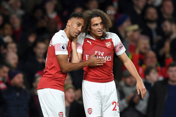 Pierre-Emerick Aubameyang of Arsenal celbrates with Matteo Guendouzi of Arsenal after he scores his sides third goal during the Premier League match between Arsenal FC and Leicester City at Emirates Stadium on October 22, 2018 in London, United Kingdom.  (Oct. 21, 2018 - Source: Shaun Botterill/Getty Images Europe)
