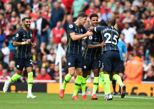 Raheem Sterling of Manchester City celebrates after scoring his side's first goal with team mates during the Premier League match between Arsenal FC and Manchester City at Emirates Stadium on August 12, 2018 in London, United Kingdom.  (Aug. 11, 2018 - Source: Michael Regan/Getty Images Europe)