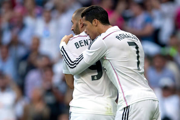 Cristiano Ronaldo (R) of Real Madrid CF celebrates scoring their opening goal with teammate Karim Benzema (L) during the La Liga match between Real Madrid CF and FC Barcelona at Estadio Santiago Bernabeu on October 25, 2014 in Madrid, Spain.  (Oct. 24, 2014 - Source: Gonzalo Arroyo Moreno/Getty Images Europe)