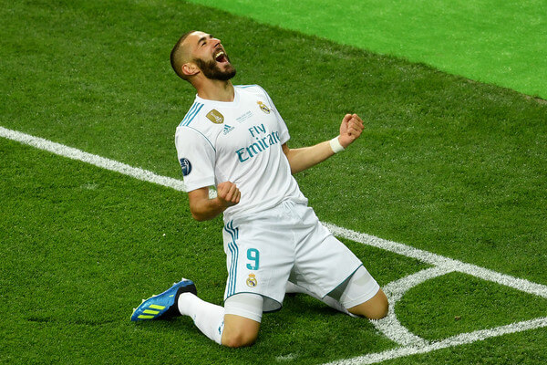Karim Benzema of Real Madrid celebrates after scoring his sides first goal during the UEFA Champions League Final between Real Madrid and Liverpool at NSC Olimpiyskiy Stadium on May 26, 2018 in Kiev, Ukraine.  (May 25, 2018 - Source: Mike Hewitt/Getty Images Europe)