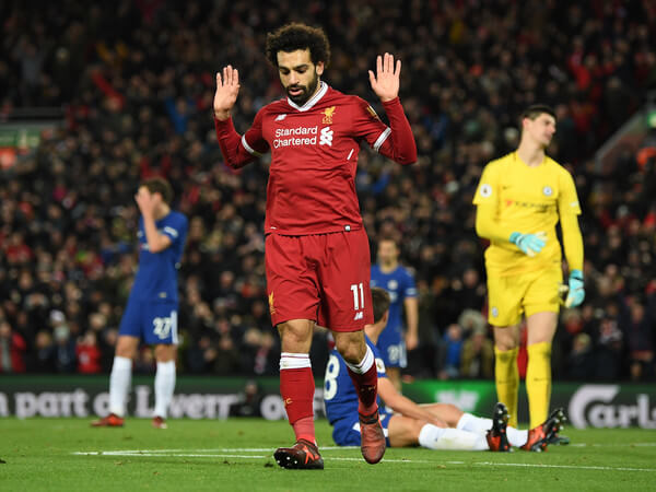 Mohamed Salah of Liverpool celebrates scoring his sides first goal during the Premier League match between Liverpool and Chelsea at Anfield on November 25, 2017 in Liverpool, England.  (Nov. 24, 2017 - Source: Shaun Botterill/Getty Images Europe)