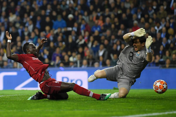 Sadio Mane of Liverpool scores his team's first goal under pressure from Iker Casillas of FC Porto during the UEFA Champions League Quarter Final second leg match between Porto and Liverpool at Estadio do Dragao on April 17, 2019 in Porto, Portugal.  (April 16, 2019 - Source: Getty Images Europe)