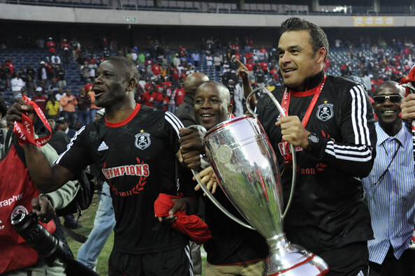 irates assitant coach Graig Rosslee celebrates with Lucky Lekgwathi after winning the Absa Premiership Final match between Orlando Pirates and the Golden Arrows at Orlando Stadium on May 21, 2011 in Soweto, South Africa.  (May 20, 2011 - Source: Gallo Images/Getty Images Europe)