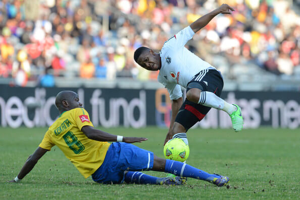Hlompho Kekana of Sundowns and Thandani Ntshumayelo of Pirates during the Absa Premiership match between Orlando Pirates and Mamelodi Sundowns at Orlando Stadium on May 11, 2013 in Soweto, South Africa.  (May 10, 2013 - Source: Gallo Images/Getty Images Europe)