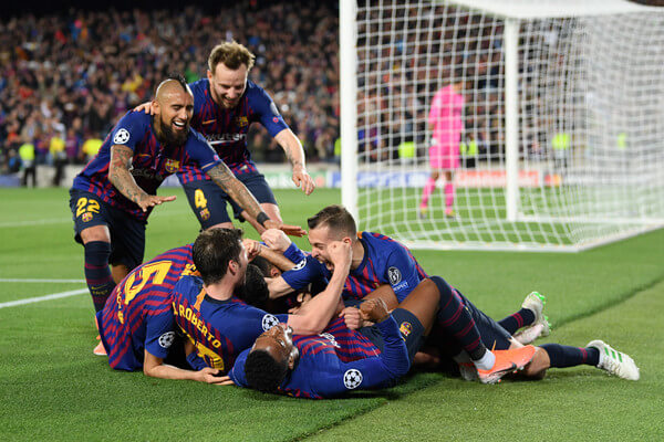 Lionel Messi of Barcelona celebrates with his team mates after he scores his sides third goal during the UEFA Champions League Semi Final first leg match between Barcelona and Liverpool at the Nou Camp on May 01, 2019 in Barcelona, Spain.  (April 30, 2019 - Source: Getty Images Europe)
