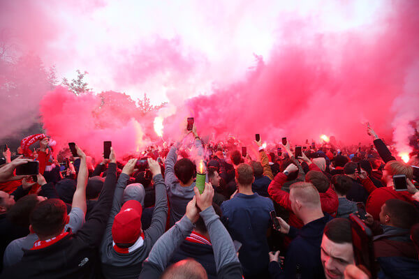 Fans of Liverpool enjoy the pre match atmosphere with flares prior to the UEFA Champions League Semi Final second leg match between Liverpool and Barcelona at Anfield on May 07, 2019 in Liverpool, England.  (May 6, 2019 - Source: Getty Images Europe)