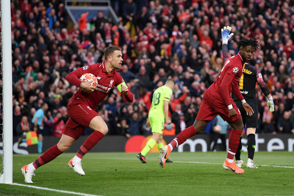 Jordan Henderson of Liverpool celebrates as Divock Origi (R) scores his team's first goal during the UEFA Champions League Semi Final second leg match between Liverpool and Barcelona at Anfield on May 07, 2019 in Liverpool, England.  (May 6, 2019 - Source: Getty Images Europe)