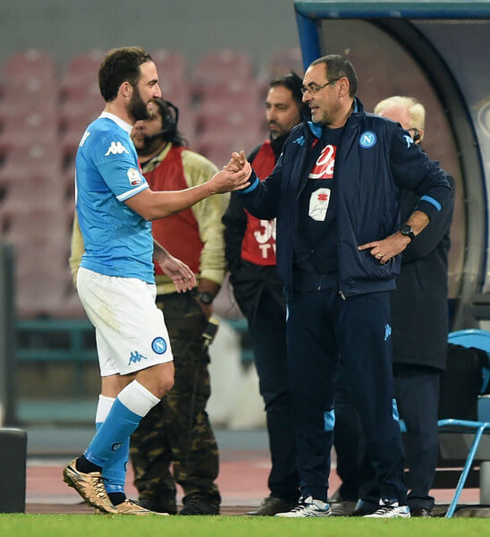 Napoli's coach Maurizio Sarri greets coach player Gonzalo Higuain during the TIM Cup match between SSC Napoli and Hellas Verona FC at Stadio San Paolo on December 16, 2015 in Naples, Italy.  (Dec. 15, 2015 - Source: Francesco Pecoraro/Getty Images Europe)