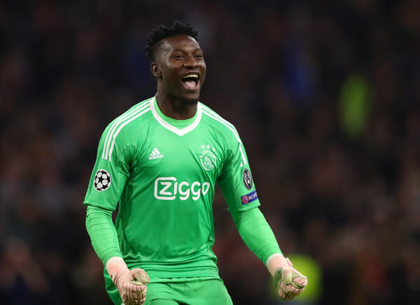 Andre Onana of Ajax celebrates after Noussair Mazraoui of Ajax (not pictured) scores his team's first goal during the Group E match of the UEFA Champions League between Ajax and SL Benfica at Johan Cruyff Arena on October 23, 2018 in Amsterdam, Netherlands.  (Oct. 22, 2018 - Source: Dean Mouhtaropoulos/Getty Images Europe)