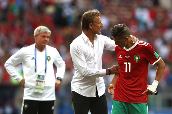 Herve Renard, Head coach of Morocco consoles Faycal Fajr of Morocco who looks dejected following his sides defeat, meaning his team are knocked out of the World Cup after the 2018 FIFA World Cup Russia group B match between Portugal and Morocco at Luzhniki Stadium on June 20, 2018 in Moscow, Russia.  (June 19, 2018 - Source: Michael Steele/Getty Images Europe)