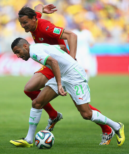 Riyad Mahrez of Algeria holds off a challenge by Daniel Van Buyten of Belgium during the 2014 FIFA World Cup Brazil Group H match between Belgium and Algeria at Estadio Mineirao on June 17, 2014 in Belo Horizonte, Brazil.  (June 16, 2014 - Source: Jeff Gross/Getty Images South America)