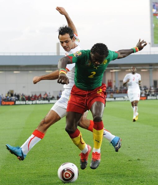 Gilles Binya of Cameroon and Oussama Darragi of Tunisia in action during the Africa Cup of Nations Group D match between Cameroon and Tunisia from the Alto da Chela Stadium on January 21, 2010 in Lubango, Angola. ((Photo by Lefty Shivambu/Gallo Images) / Getty Images)(Jan. 20, 2010 - Source: Gallo Images/Getty Images Europe)