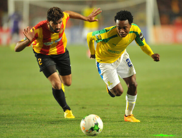 South Africa's Sundowns striker Percy Tau vies with Tunisia's Esperance of Tunis defender Ali Machani (L) during the African Champions League (CAF) group stage football match on June 22, 2017 in olympic Rades Stadium near Tunis. / AFP PHOTO / SALAH HABIBI  (June 20, 2017 - Source: AFP)