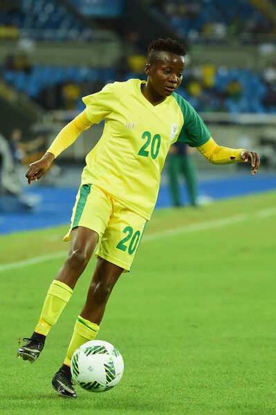 Thembi Kgatlana of South Africa runs with the ball during the Women's Group E first round match between South Africa and China PR on Day 1 of the Rio 2016 Olympic Games at the Olympic Stadium on August 6, 2016 in Rio de Janeiro, Brazil.  (Aug. 5, 2016 - Source: Harry How/Getty Images South America)