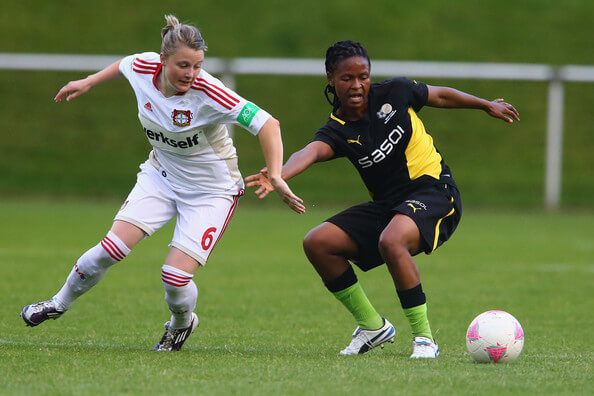Claudia Goette of Leverkusen challenges Amanda Dlamini of South Africa during the women's friendly match between South Africa and Bayer Leverkusen at Sport School Hennef on July 12, 2012 in Recklinghausen, Germany.  (July 11, 2012 - Source: Christof Koepsel/Getty Images Europe)