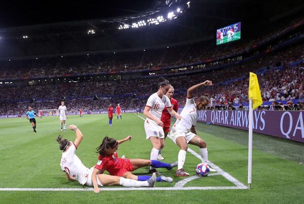 Alex Morgan of the USA is challenged by Lucy Bronze, Jade Moore and Nikita Parris of England during the 2019 FIFA Women's World Cup France Semi Final match between England and USA at Stade de Lyon on July 02, 2019 in Lyon, France.  (July 1, 2019 - Source: Getty Images Europe