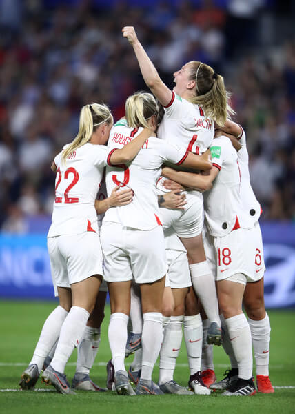Lucy Bronze of England celebrates with teammates after scoring her team's third goal during the 2019 FIFA Women's World Cup France Quarter Final match between Norway and England at Stade Oceane on June 27, 2019 in Le Havre, France.  (June 26, 2019 - Source: Getty Images Europe)