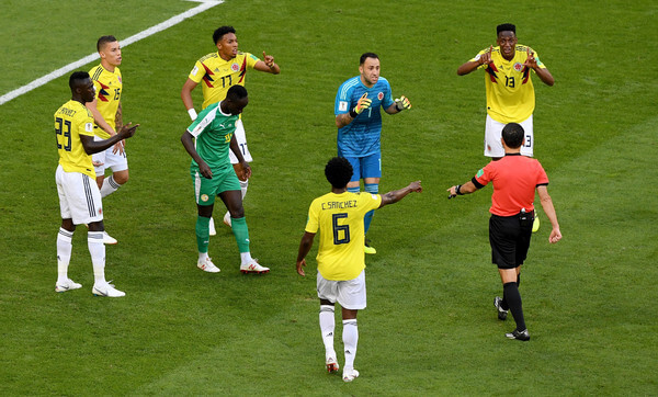 Colombia players confront referee Milorad Mazic after he awards Senegal a penalty before rescinding the decision after reviewing VAR footage during the 2018 FIFA World Cup Russia group H match between Senegal and Colombia at Samara Arena on June 28, 2018 in Samara, Russia.  (June 27, 2018 - Source: Stu Forster/Getty Images Europe)