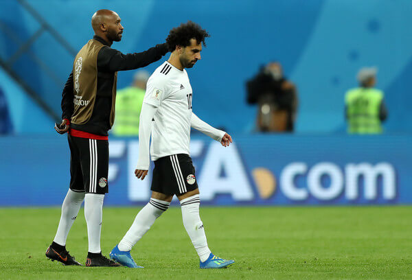 Mohamed Salah of Egypt is consoled by team mate Shikabala the 2018 FIFA World Cup Russia group A match between Russia and Egypt at Saint Petersburg Stadium on June 19, 2018 in Saint Petersburg, Russia.  (June 18, 2018 - Source: Richard Heathcote/Getty Images Europe)