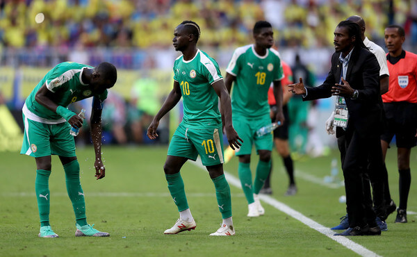 Aliou Cisse, Head coach of Senegal gives instructions to Cheikhou Kouyate and Sadio Mane of Senegal during the 2018 FIFA World Cup Russia group H match between Senegal and Colombia at Samara Arena on June 28, 2018 in Samara, Russia.  (June 27, 2018 - Source: Michael Steele/Getty Images Europe)