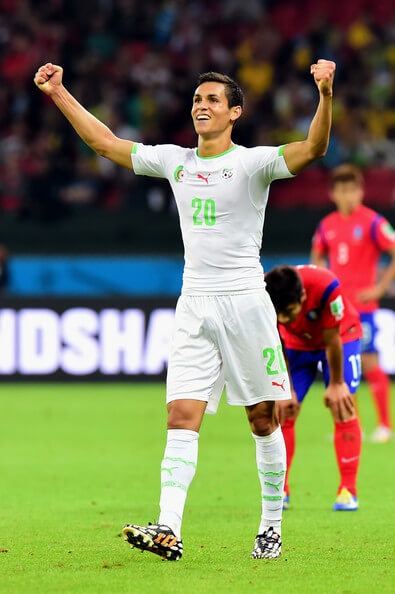 Aissa Mandi of Algeria celebrates after defeating South Korea 4-2 during the 2014 FIFA World Cup Brazil Group H match between South Korea and Algeria at Estadio Beira-Rio on June 22, 2014 in Porto Alegre, Brazil.  (June 21, 2014 - Source: Vinicius Costa/Getty Images South America)