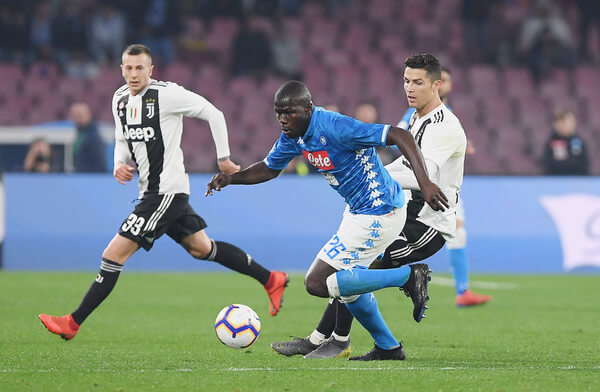 Kalidou Koulibaly of SSC Napoli vies Cristiano Ronaldo of Juventus during the Serie A match between SSC Napoli and Juventus at Stadio San Paolo on March 3, 2019 in Naples, Italy.  (March 2, 2019 - Source: Francesco Pecoraro/Getty Images Europe)
