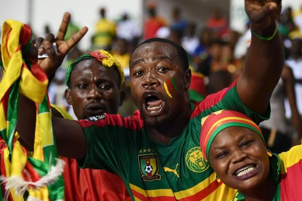 Cameroon supporters cheer for their team ahead of the 2017 Africa Cup of Nations group A football match between Cameroon and Guinea-Bissau at the Stade de l'Amitie Sino-Gabonaise in Libreville on January 18, 2017. / AFP / GABRIEL BOUYS  (Jan. 17, 2017 - Source: AFP)