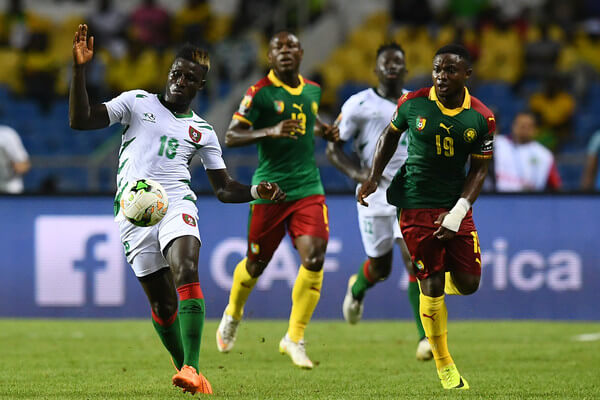Guinea-Bissau's forward Piqueti advances with the ball past Cameroon's defender Collins Fai before scoring a goal during the 2017 Africa Cup of Nations group A football match between Cameroon and Guinea-Bissau at the Stade de l'Amitie Sino-Gabonaise in Libreville on January 18, 2017. / AFP / GABRIEL BOUYS  (Jan. 17, 2017 - Source: AFP)