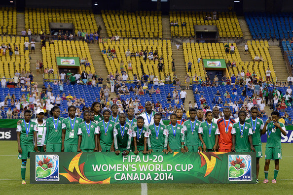 Team Germany poses for a photo with the championship trophy and their gold medals during the FIFA Women's U-20 Final at Olympic Stadium on August 24, 2014 in Montreal, Quebec, Canada. Germany defeated Nigeria 1-0 in overtime.  (Aug. 23, 2014 - Source: Richard Wolowicz/Getty Images North America)