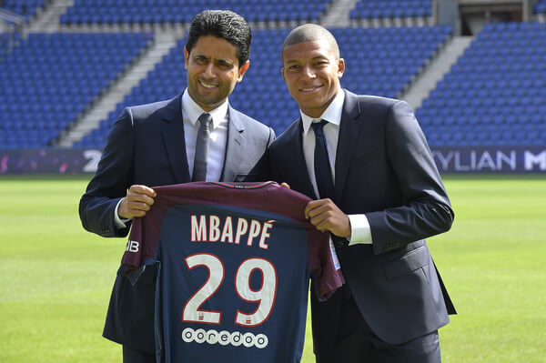 (L-R) Paris Saint-Germain President Nasser Al Khelaifi poses alongside new signing Kylian Mbappe at the Parc des Princes on September 6, 2017 in Paris, France. Kylian Mbappe signed a five year contract for 180 Million Euro.  (Sept. 5, 2017 - Source: Aurelien Meunier/Getty Images Europe)