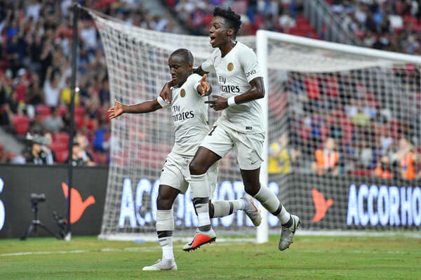 Moussa Diaby and team mate Timothy Weah of Paris Saint Germain celebrates his goal during the International Champions Cup match between Paris Saint Germain and Clu b de Atletico Madrid at the National Stadium on July 30, 2018 in Singapore.  (July 29, 2018 - Source: Thananuwat Srirasant/Getty Images AsiaPac)