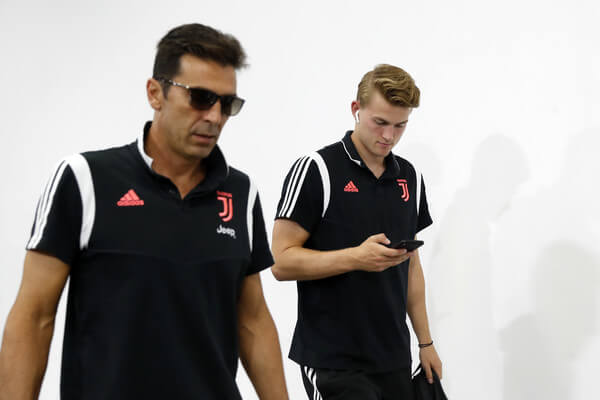 Gianluigi Buffon (L) and Matthijs de Ligt (R) of Juventus are seen on arrival at the stadium prior to the International Champions Cup match between Juventus and FC Internazionale at the Nanjing Olympic Center Stadium on July 24, 2019 in Nanjing, China.  (July 23, 2019 - Source: Getty Images AsiaPac)