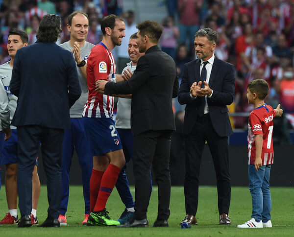 Diego Godin of Atletico Madrid chats with Diego Simeone, manager of Atletico Madrid after Godin's last home match for the club at the end of the La Liga match between Club Atletico de Madrid and Sevilla FC at Wanda Metropolitano on May 12, 2019 in Madrid, Spain.  (May 11, 2019 - Source:/Getty Images Europe)