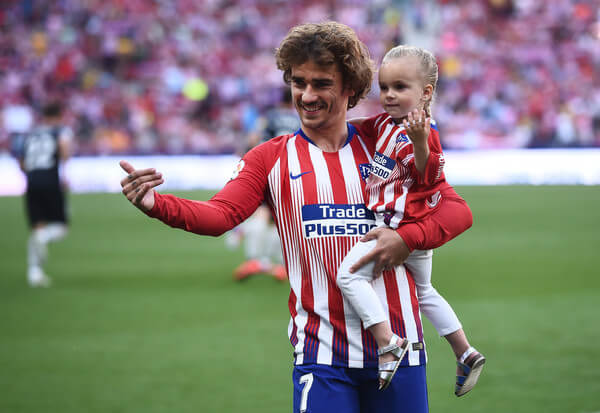 Antoine Griezmann of Club Atletico de Madrid holds his daughter Mia during the La Liga match between Club Atletico de Madrid and Sevilla FC at Wanda Metropolitano on May 12, 2019 in Madrid, Spain.  (May 11, 2019 - Source: Getty Images Europe)