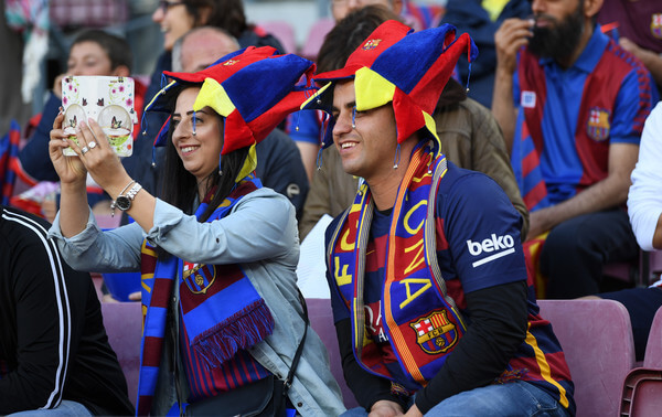 Two Barcelona fans enjoy the pre match atmosphere prior to the La Liga match between Barcelona and Real Madrid at Camp Nou on May 6, 2018 in Barcelona, .  (May 5, 2018 - Source: David Ramos/Getty Images Europe)
