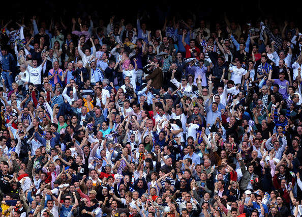 Real Madrid supporters celebrate as their side scores the opening goal during the La Liga match between Real Madrid and Barcelona at the Santiago Bernabeu Stadium on May 2, 2008 in Madrid, Spain. Barcelona won the match 6-2.  (May 2, 2009 - Source: Jasper Juinen/Getty Images Europe)