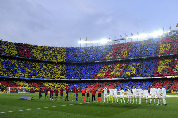 Players and officials line up prior to the La Liga match between Barcelona and Real Madrid at Camp Nou on May 6, 2018 in Barcelona, Spain.  (May 5, 2018 - Source: Alex Caparros/Getty Images Europe)