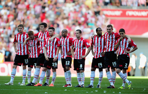 Dejection for players of Sheffield United during the npower League One, playoff final between Huddersfield Town and Sheffield United at Wembley Stadium on May 26, 2012 in London, England.  (May 25, 2012 - Source: Jamie McDonald/Getty Images Europe)