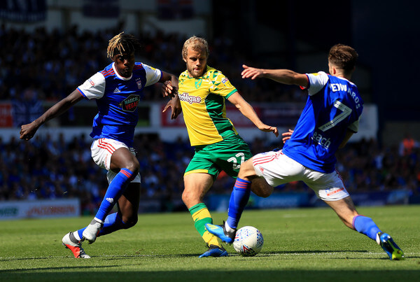 Teemu Pukki of Norwich City is blocked by Trevoh Chalobah and Gwion Edwards of Ipswich Town during the Sky Bet Championship match between Ipswich Town and Norwich City at Portman Road on September 2, 2018 in Ipswich, England.  (Sept. 1, 2018 - Source: Stephen Pond/Getty Images Europe)